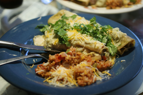 Chicken Enchilads served with a side of Mexican Rice