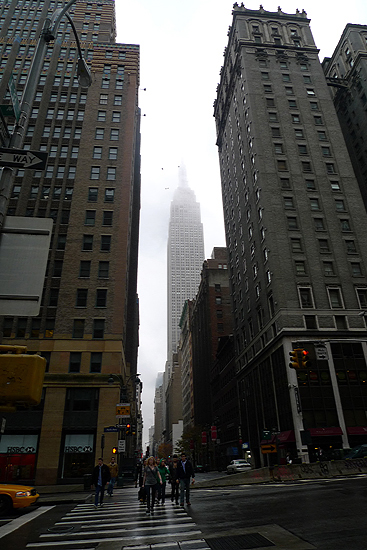 The Empire State Building, crowned in fog.